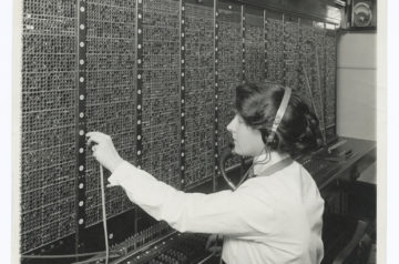 Woman operating an old phone switchboard